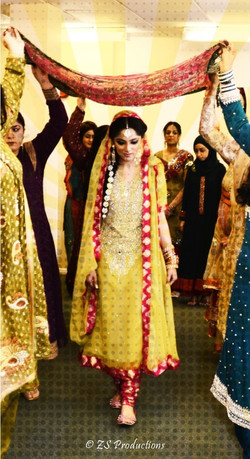 Bride wearing a mehndi dress and making an entrance