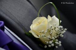 Groom wedding suit in grey with flower pin