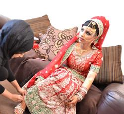 Beautiful traditional desi Pakistani bride getting ready