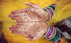 Intricate wedding henna and mehndi tattoo on hands