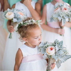 Precious flower girls holding the brides