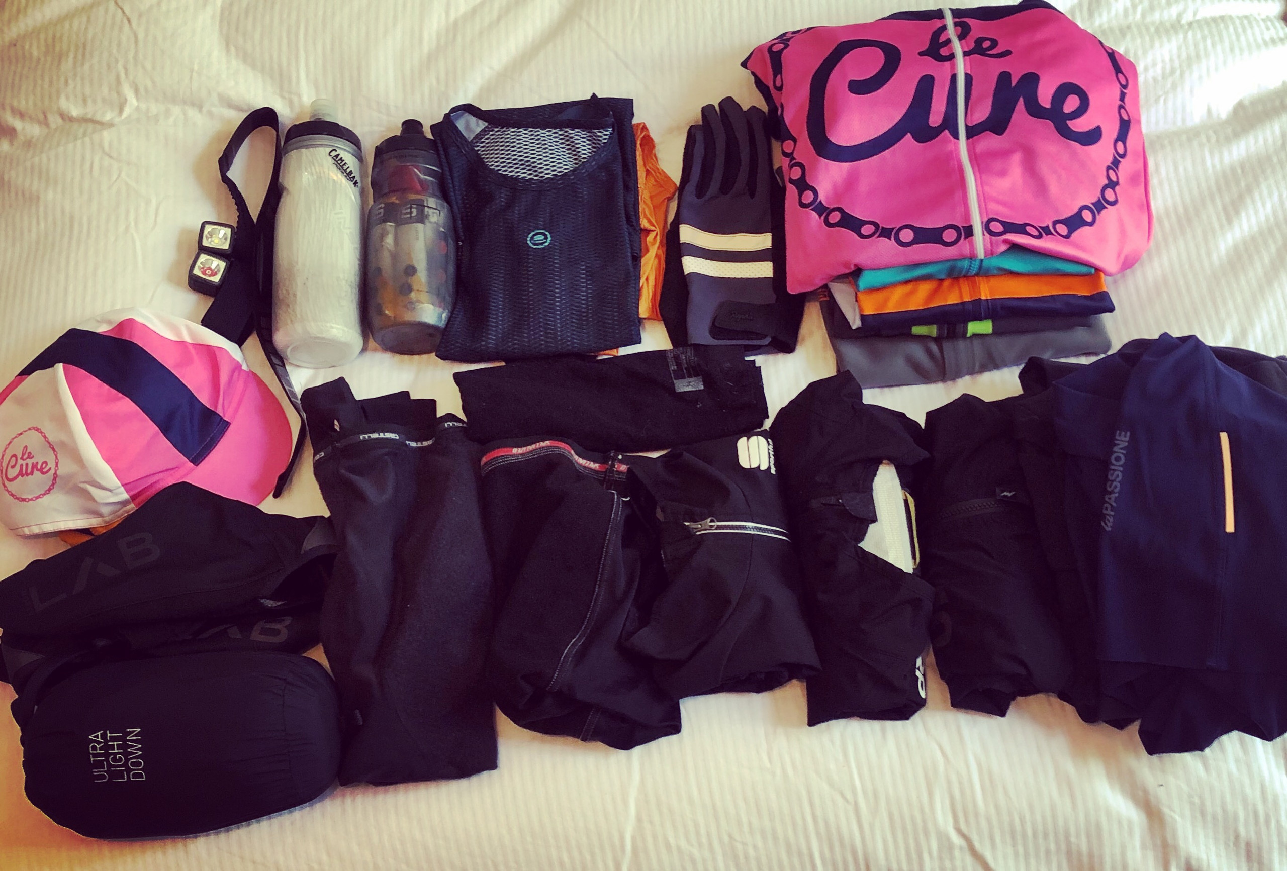 cycling kit laid out across bed