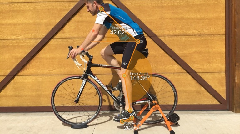 cyclist on static trainer with measurements overlaid