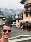 person in mountain village with mountains in background