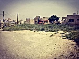 قطعة أرض للبيع مساحة 400م في ضاحية الرشيد قرب الكلية العلمية الإسلامية