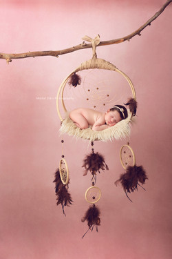 baby on a dream catcher