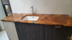 Aged copper worktops