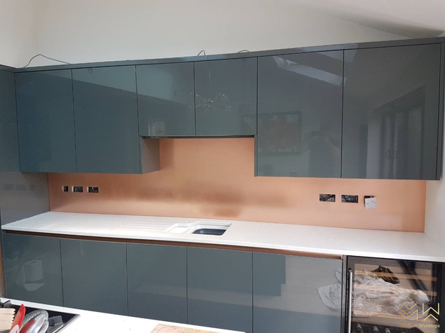Wide brushed Copper splashback