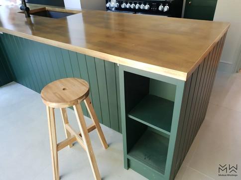 Brass island finished with custom wood-like patina