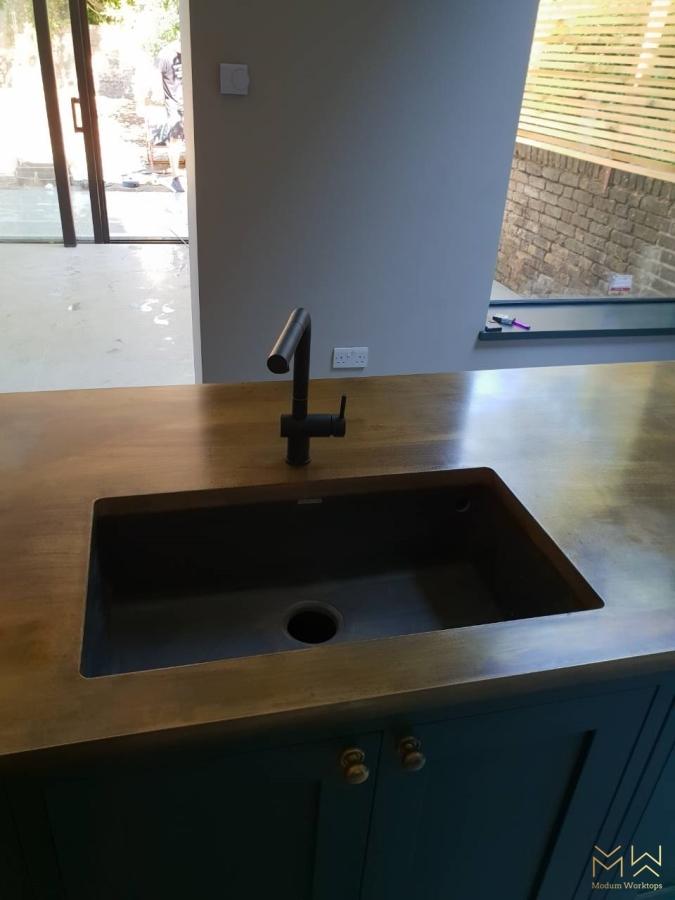 Brass under-mounted sink