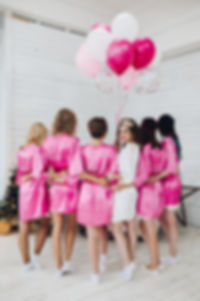 Back view of group of bridesmaids with b
