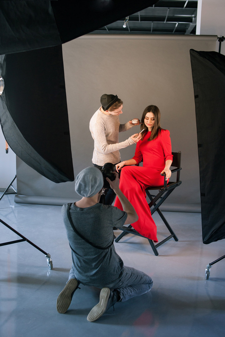 Photographer and stylist work in studio