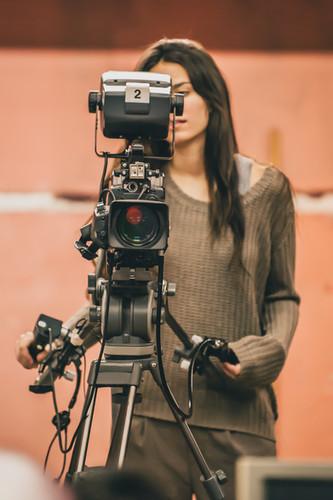 Behind the scene. Female cameraman shoot
