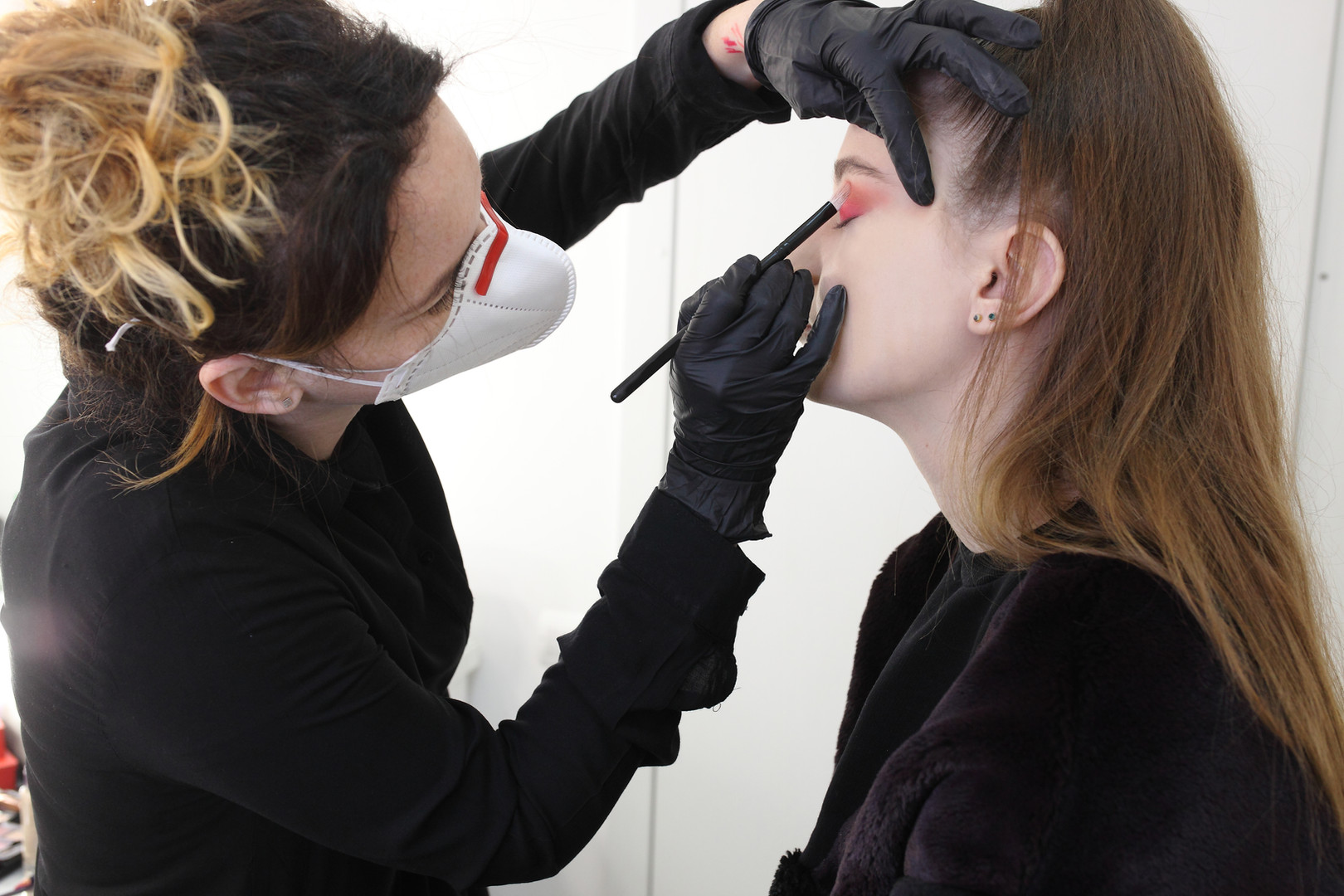 Makeup artist wearing a medical mask.jpg