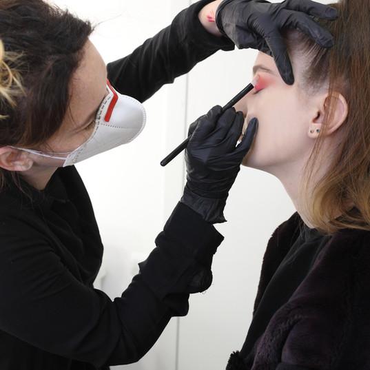 Makeup artist wearing a medical mask.jpg