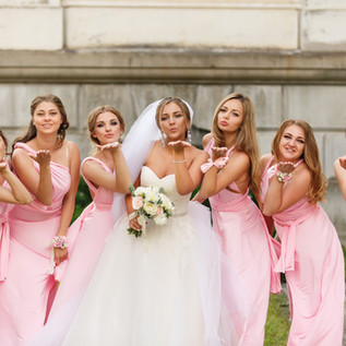 Bride and bridesmaids in pink dresses ha