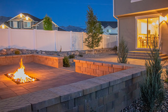Wide, ground-level firepit - utah landscaping