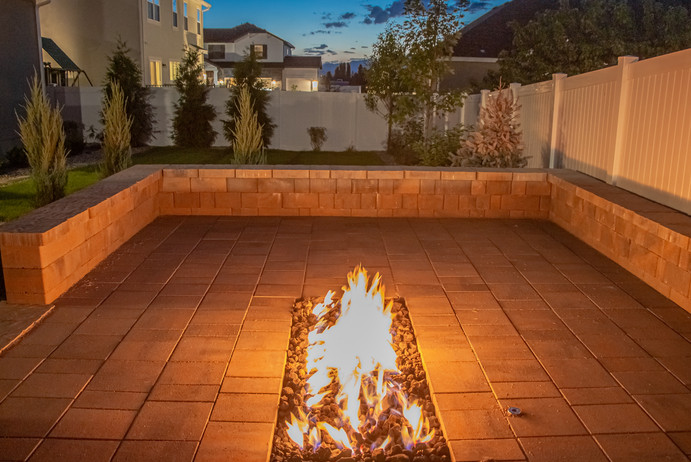 Fire pit - at night - utah landscaping