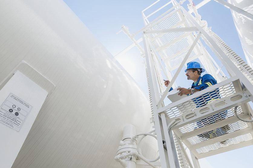 Engineer Inspecting Gas Line