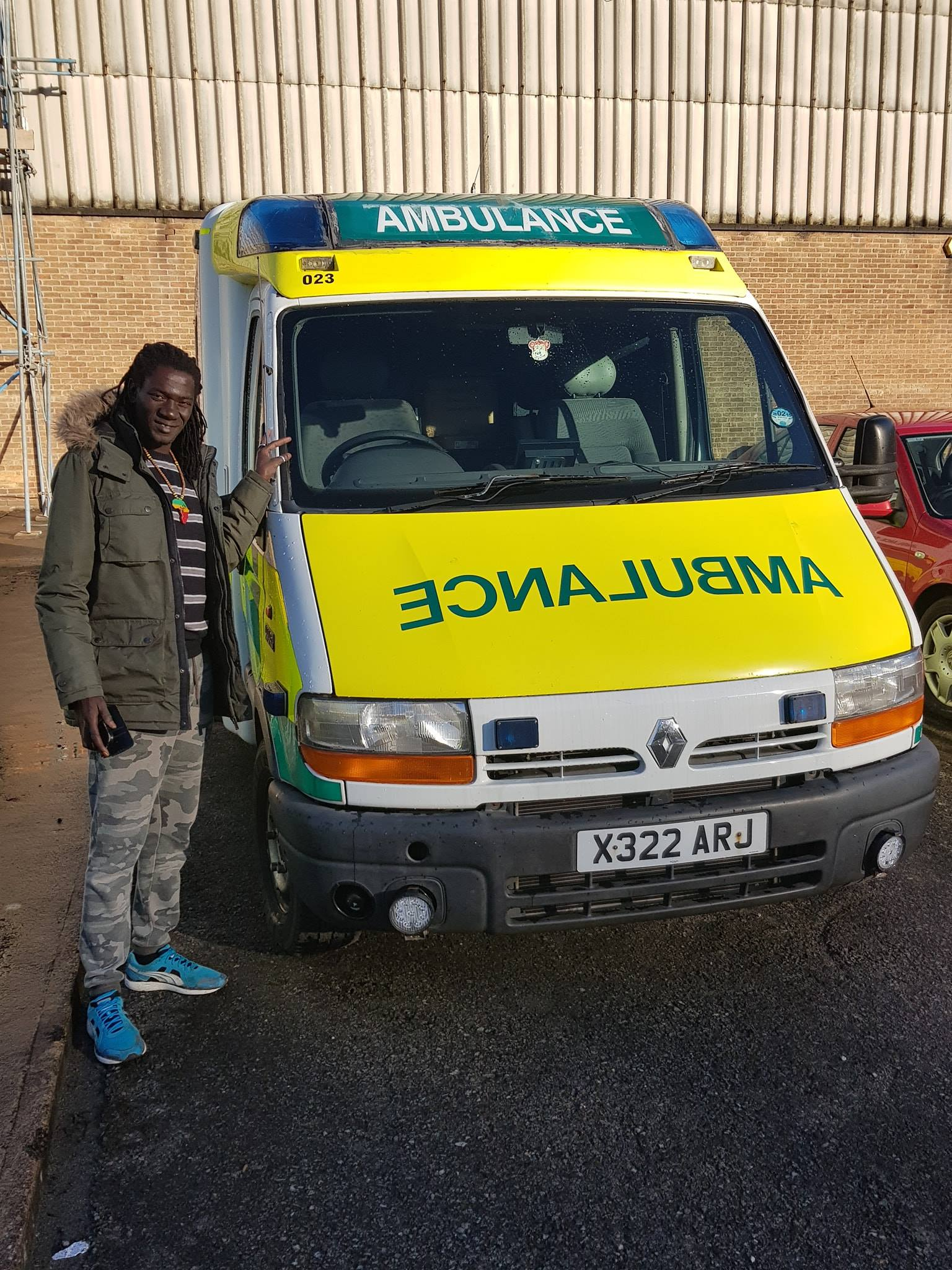 Baba with one of the Ambulances