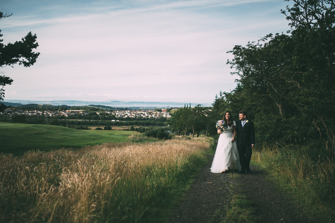 Bride and Groom with view over Edinburgh