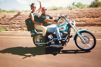 CH.11-3  Win & Cy waving on aqua Harley.