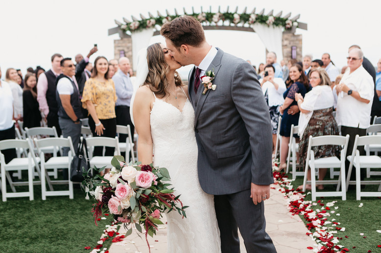 CEREMONY BRIDE & GROOM It's Just the Beginning..Big kiss at the pavillion burgundy blush cream rustic elegance _@PacificViewsEventCenter
