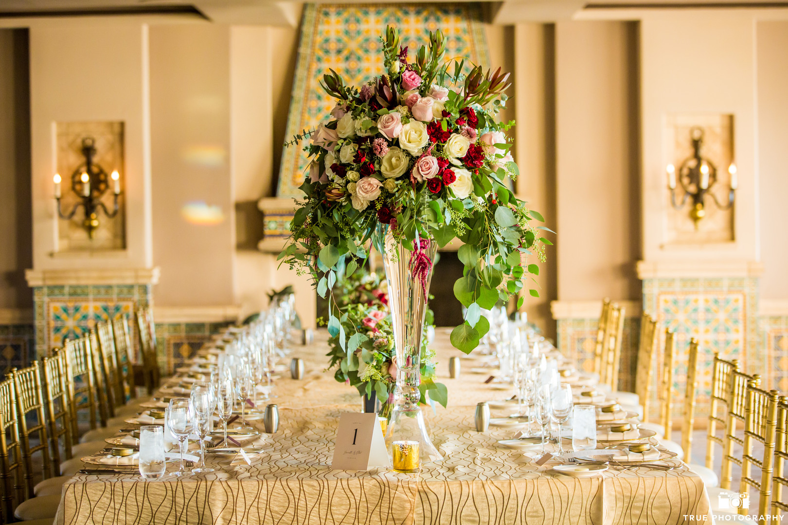 Opulent centerpiece in tall glass vases