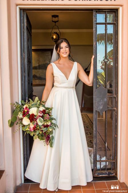 Dani bride in doorway with bouquet