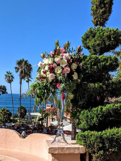 Opulent ceremony arrangement in tall gla