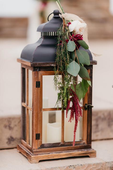 CEREMONY Pavillion steps lanterns close up right side brown lantern just before the start..burgundy blush cream rustic elegance _@PacificViewsEventCenter