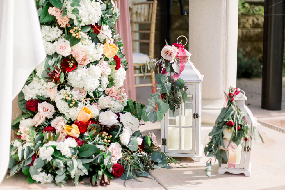 ceremony decor right column full flowers blush cream peach maroon burgundy