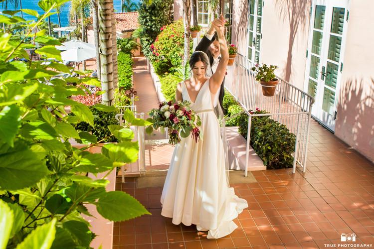 Bride-Dani twirls with Groom-Clint in pr