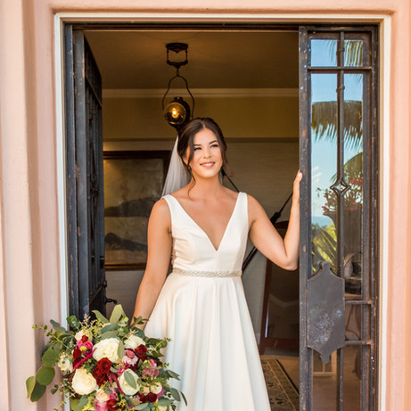 Dani bride in doorway with luxury cascade bouquet @lavalenciahotel