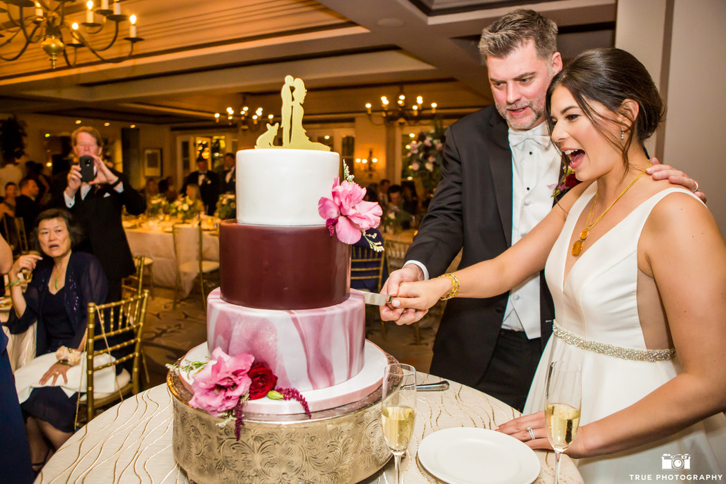 Dani & Clint _LaValenciaHotel bride and groom cutting the cake