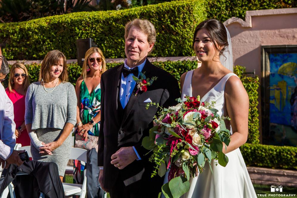 Bride-Dani walks up the aisle with fathe