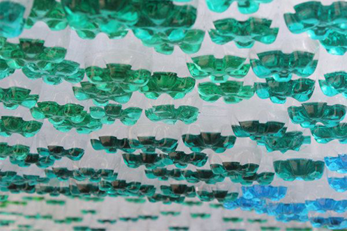 PET art, botellas con liquido verde