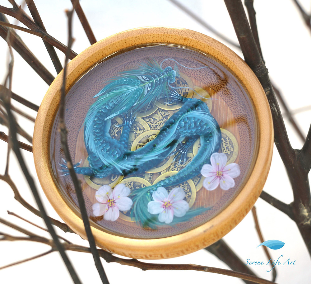 Teal Leviathon with Cherry Blossoms is a stark and vivid representation of Leviathon, a mythical Jewish dragon. The 3D art with resin comprises a gorgeously rendered dragon crawling on the Chinese golden coins and three cherry blossoms nearby the tail. Dragons are primarily associated with treasure, immense powers, and laudable features. With the addition of flowers, the piece inserts a quality of sensitivity, compassion, and nobility.