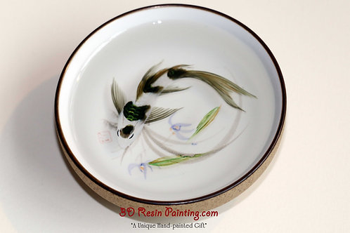 White and black koi fish resin painting in a Chinese style teacup