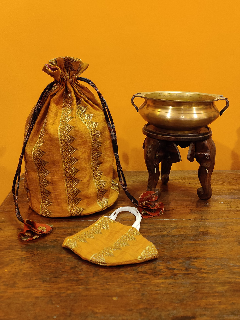 Golden diwali potli bag with matching mask