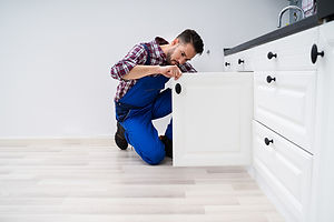bigstock-Young-Handyman-Fixing-Sink-Doo-