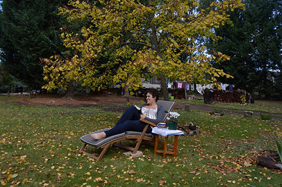 Autum, a deciduous beautiful european tree with Jenna reading a book.