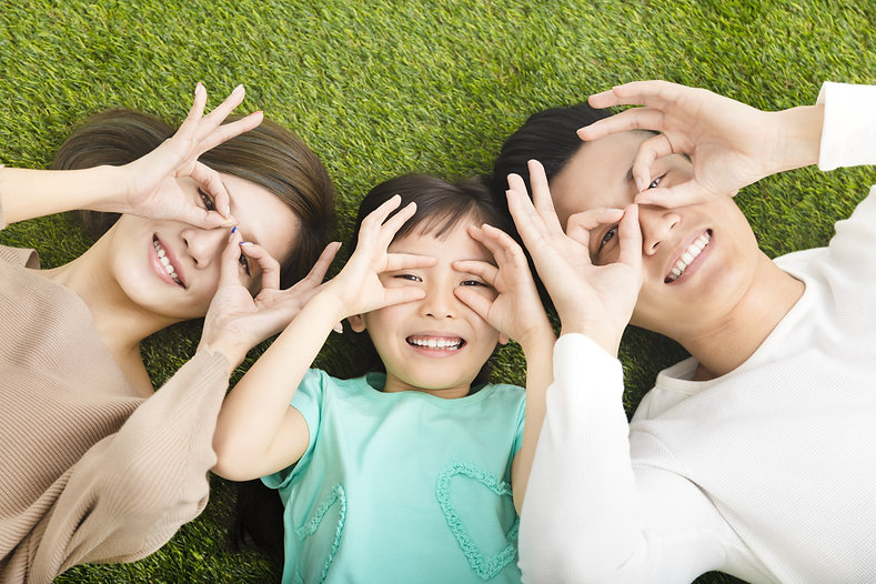 top view of Happy  Young  Family lying o