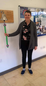 Cate rings the special bell at the hospital to mark the end of her treatment.