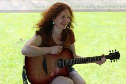Ilona learns the strumming arts