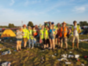 A group of volunteers at the end of Reading Festival clearing abandoned tents