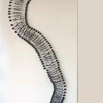 HELENA TRINDADE  Vírus (de parede)   2018 Escultura de teclas de máquinas de escrever e suas hastes extensão 190 cm montada 140 x 70 x 06 cm