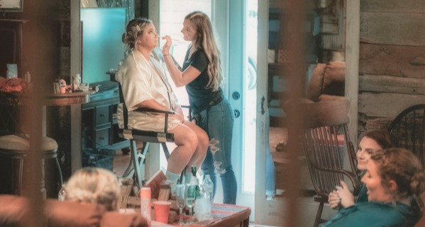 Bride getting ready for her Rustic Destination Wedding at Wicked Pony Ranch