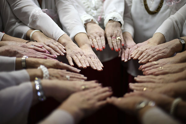 Women team put all hands together.jpg
