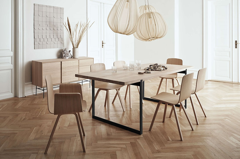 bolia frame dining table with palm dining chairs